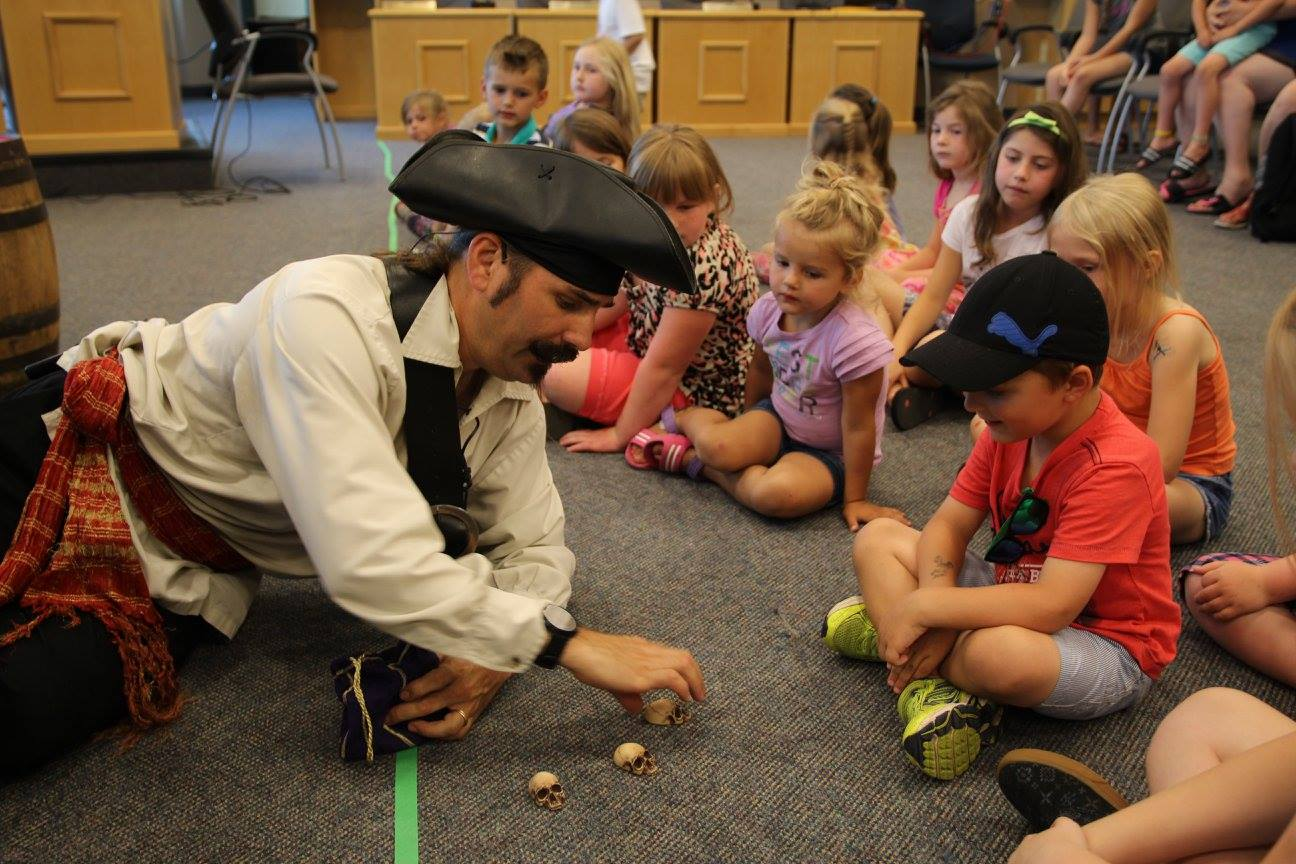 Pirate performing march break magic show at Ontario library
