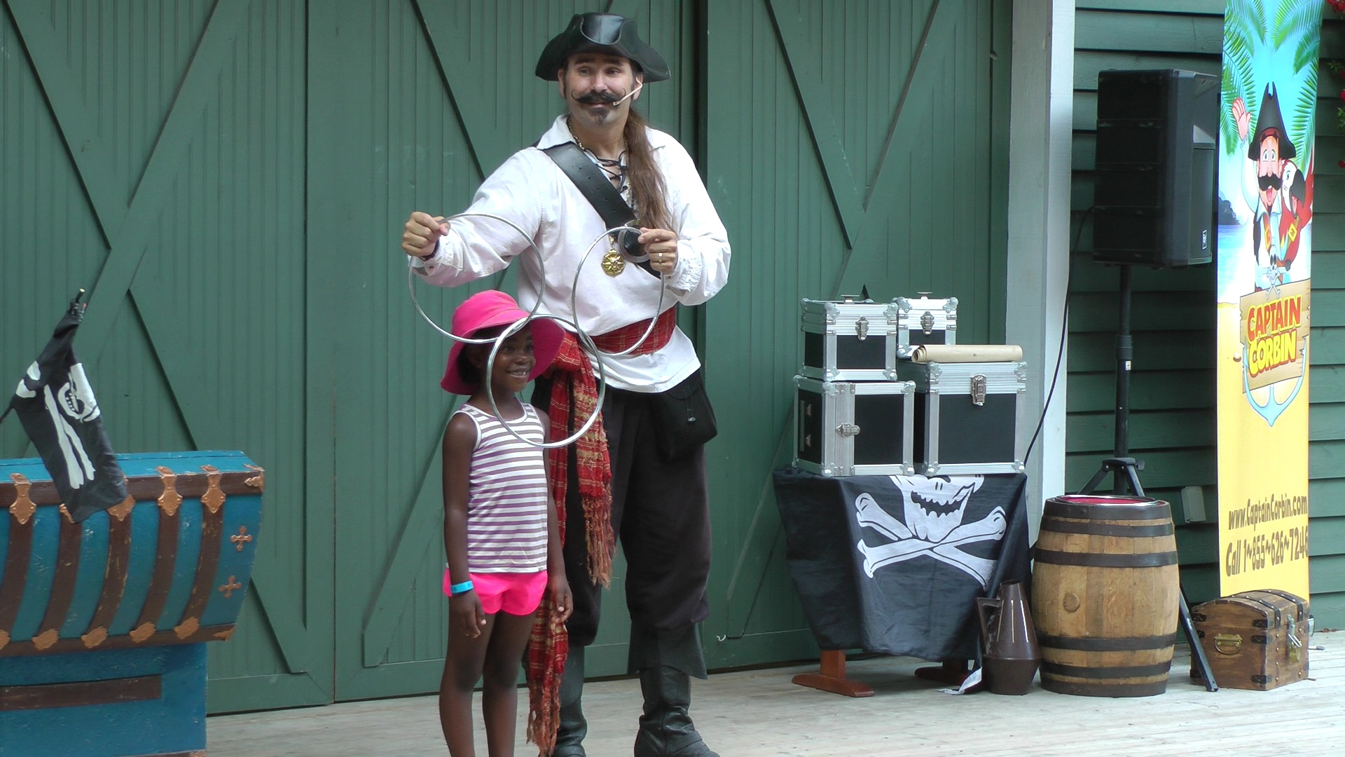 Corbin performing a pirate magic show at Storybook gardens